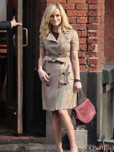 I like the short-sleeved trench with the wine-colored accents