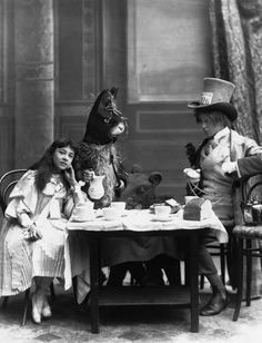 """The Mad Hatter's Tea Party from """"Alice in Wonderland"""" with Rosa Hersee as Alice and Arthur Elliot as the Hatter at the Opera Comique Theatre in London,  1898. © London Stereoscopic Company."""