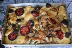 Roast chicken and potatoes Murcian style after roasting in the local bakery.