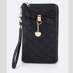 "Black quilted double zip wristlet Black quilted double zip wristlet Measures: 7"" long/ 4"" tall. Brand new without tags- this was purchased from the manufacturer. Two zippers. Both sections are padded and perfect for a cell phone or cards. Gold hardware. Availability- 3 PLEASE do not purchase this listing. Price is firm unless bundled. No trades Bags Clutches & Wristlets"