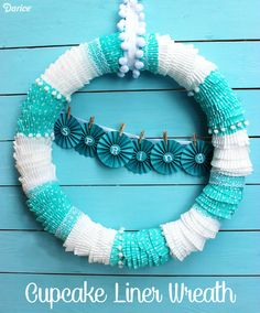 Brighten up your front door with this fun DIY cupcake liner wreath tutorial. It's simple to make and easily customized based on your color choices!
