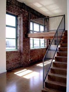 heavens, no, i haven't broken up with my love of exposed brick.  look at all the potential this loft has.  must. move. in. now.