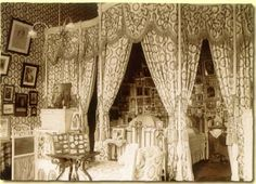 Pre-1917 view.   The Alexander Palace : The Imperial Bedroom  Set in an alcove was the Imperial bed made up of two gilt-bronze twin beds. Behind it were hundreds of icons and religious items hung on cords. To the right of the bed was an icon-stand. Most of the icons and other items, totaling 700, were gifts to the Imperial family from important monasteries, churches, religious organizations, military units and private persons.  The Bedroom's finish and furnishings have not survived.