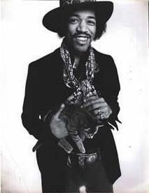 Jimi Hendrix holding a cat.