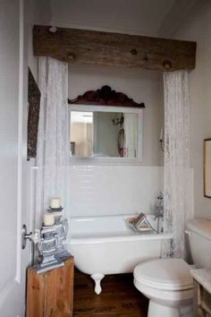 Curtained Claw Foot Tub... I should have know it was Penny who found this beautiful bathroom décor! L.O.V.E. the rustic beam holding the shower curtain rod...very lovely, keeping the bath from being too 'girly'.