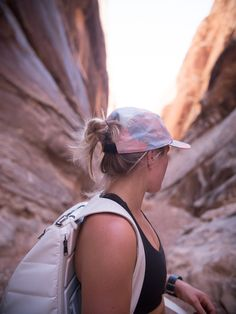 Norwegian freeskier Hedvig Wessel wearing our neon cap from the Spring / Summer 17 collection #freeskier #fashion #SS17 #cap #canyon #peakperformance #hiking #outdoor #active