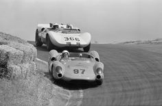 Dave MacDonald uses all of the road and then some in the Laguna Seca corkscrew, May 3, 1964. Hot on his heals is Jim Hall. Hall would get by MacDonald for the win, with Roger Penske in a second Chaparral taking 3rd. MacDonald was scheduled to drive Bill Stroppe's NASCAR Ford that weekend, but with Hall threatening to overtake MacDonald in the USRRC points, Shelby elected to send him to Laguna Seca instead. William Hewitt photo.