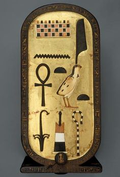 *EGYPT ~ CHEST of TUTANKHAMUN: In the shape of a cartouche,this gilded wood chest from King Tutankhamun's tomb is inlaid w/ivory, ebony+ various colored pastes. A cartouche is an oval figure enclosing a sovereign's name. Ancient Egyptian Artifacts, Egyptian Symbols, Ancient History, Egyptian Hieroglyphs, King Tut Tomb, Egypt Art, Cairo Egypt, Ancient Civilizations, Monuments