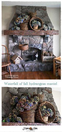 A waterfall of fall hydrangeas in rustic baskets for a fall mantel look - via http://www.funkyjunkinteriors.net/
