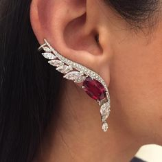 A marvellous pair of earrings set with meticulously chosen natural oval Rubies from Tanzania adorned with marquise and brilliant cut diamonds, once again part of the delicate Saut d'Ange collection.