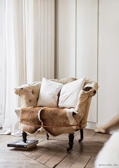 Love this chair from Méchant Studio Blog  natural cow hide interior design space inspiration beautiful light #jotitdown