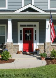 Pretty red front door and American flag - has gray siding a lil bit darker than my house...I think I love it!