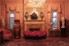 The @McFaddin-Ward House Museum pink parlor looking gorgeous this holiday season with fresh flowers--lovely pink poinsettias and roses. This room is one of our favorites with lots of feminine touches and a hand painted ceiling. What's not to love?