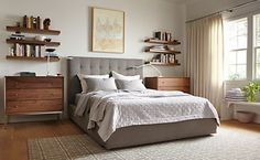 Soft fabric upholstery embellished with tufting puts a modern twist on a classic style. Featuring quality craftsmanship, the Avery storage bed with a tall headboard adds texture and color to your room. Plus, a hidden drawer pulls out from the foot of the bed to add storage space. No box spring required.