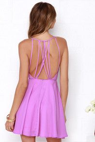 Happiness is good company, and a memorable evening in the Strappy Together Orchid Purple Dress! A chic, apron bodice meets a series of skinny straps that loop and cross over the sexy open back. Princess seams accentuate the fitted bodice that meets the full skater skirt.