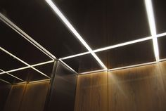 Glowing Reveals of a Suspended Black Stainless Steel Ceiling
