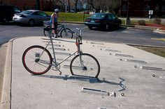 Would you park your bike here? The front-wheel only cable lock solution is especially clever! Seen at the Chicago Heights Park District headquarters and library building. Photo CC BY-NC-SA by S… Urban Furniture, City Furniture, Furniture Outlet, Metal Furniture, Discount Furniture, Furniture Plans, Affordable Furniture Stores, Luxury Furniture Brands, Inexpensive Furniture