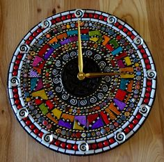 Custom Made Razzle Dazzle Mosaic Clock round mosaic clock comprised of handpainted ceramic tiles, handpainted cabochons, ball chain, millefiori, and glass border tiles. Mirror Mosaic, Mosaic Diy, Mosaic Crafts, Mosaic Projects, Mosaic Glass, Mosaic Tiles, Mosaic Designs, Mosaic Patterns, Mosaic Madness