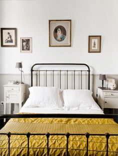 dark bed frame with white and mustard bedding. White Bedside Table, Interior, Home, Home Bedroom, House Interior, Bedroom Inspirations, Country Bedroom, Wrought Iron Beds, Iron Bed