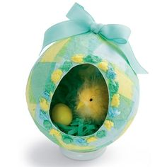 Paper Egg Diorama -- instructions for making the papier-mache egg from scratch, but craft stores sell them as well.