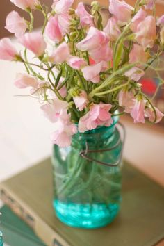 sweet peas and mason jars.  Lovely. Sweet peas were one of my mom's favorite flowers.