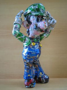 Mario characters made out of aluminum cans