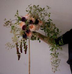 Ariel Dearie flowers styled on a branch.