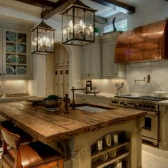 wood beams in recessed lighting area; island counter surface
