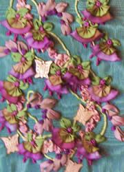 Silk ribbon embroidery, with ribbon worked flowers and leaves.