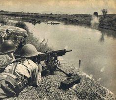 Japanese Soldier Firing Type 92 Machine Gun across Milou River by  Unknown Artist