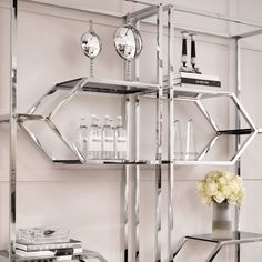Welcome the urban modern appeal of the Myconian Cabinet into your home. With its beautiful geometric design, this gorgeous etagere adds a focal point to your hallway, lounge or bedroom. The polished stainless steel frame contains two small and four larger smoke glass shelves. #eichholtz #homestory Richmond Interiors, Glass Shelves, Ceiling Lamp, Steel Frame, Bathroom Medicine Cabinet, Cleaning Wipes, Designer, Modern Furniture, Stainless Steel
