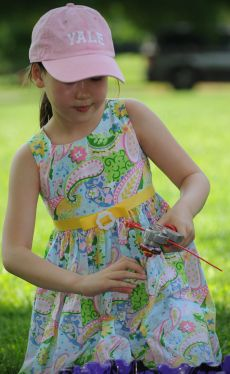Annie Nelson, 7, prepares to launch her Beyblade top at Garst Mill Park in Roanoke County. Photo by Don Peterson l Special to The Roanoke Times.