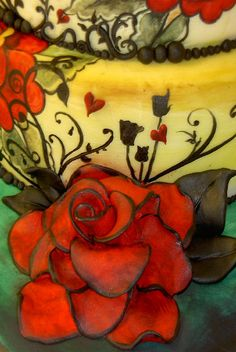 Tattoo-inspired wedding cake with intricately painted detail by artist Nicola Shipley of Tattoo Cakes, Woking, England....