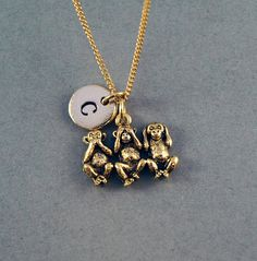 ❖ Inventory Replacement Sale ❖ ❖ Three Monkeys charm in Antique Gold Pewter. Approx: X Lead free pewter charm made in U. ❖ Hand Stamped Initial Charm - Antique Gold Pewter ❖ Click below for three monkeys necklace in Antique Silver Pewter: Three Wise Monkeys, Gold Necklace, Initial Necklace, Initial Charm, Brown And Grey, Hand Stamped, Antique Silver, Initials, Unique Gifts