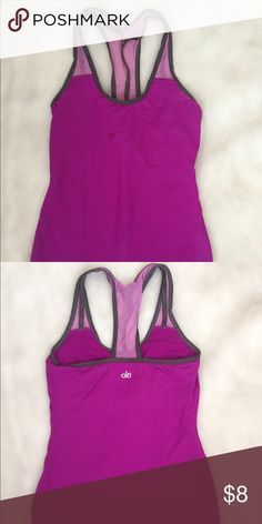 Workout racer back tank Magenta racer back workout tank with strappy/mesh back and non-padded bra insert, excellent used condition Tops Tank Tops