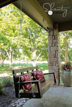 DIY WOOD PORCH SWING/love the stones on the pole