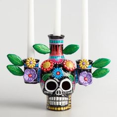 One of my favorite discoveries at WorldMarket.com: Dia de los Muertos Skull Candleholder