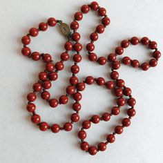 Vintage Hand-Knotted Rusty Red Glass Beaded Necklace - Ornate Sterling Silver Oval Box Clasp - 32-inch Strand - Opaque Red Beads