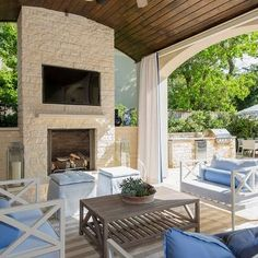 Beautiful, Traditional Covered Patio Area Featuring A Brick Fireplace,  Exposed Wooden Ceilings, Canvas