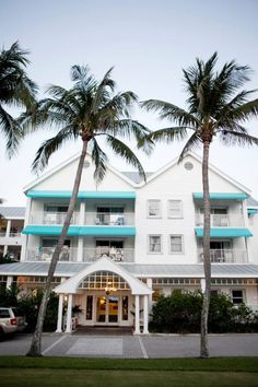 On a private peninsula overlooking the Atlantic Ocean, the Hillsboro Club in Hillsboro Beach, FL is known for its stately elegance and style. The charm of the seaside venue is evident in the palm tree lined drive, stately columns, teal awnings, and white siding. One fun and classy beach wedding held here featured the John Parker Band. http://www.jpband.com/weddings.html