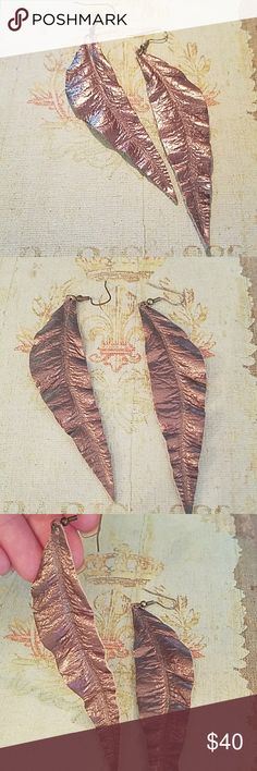 Leather Feather Earrings Soft leather earrings. Metallic bronze color. I bought them at a boutique and Austin. Just too big for my taste. But I love them so much I bought them anyways Boutique Jewelry Earrings