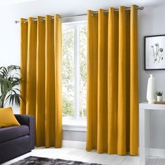Sorbonne Ochre Eyelet Curtains Yellow and Gold