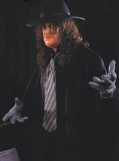 As a kid I was both fascinated and terrified of this WWF wrestler........The Undertaker!