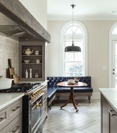Kate Roos Design | fabulous kitchen with corner banquet and English Table and did I mention the fabulous stove in black & gold