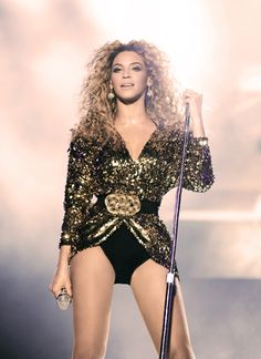 Beyoncé doing what she does best... Taking over the stage. First woman to perform at Glastonbury and she ROCKED it out!