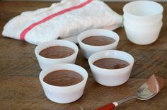 Dairy-free Chocolate Pots de Creme made with a mere five ingredients --dark chocolate, coconut milk, egg yolk, salt, and stevia. Paleo dessert recipe.