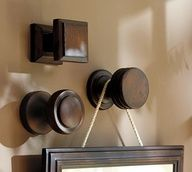 Drawer pulls as picture hangers. Neat idea.