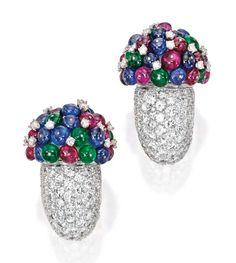 Pair of platinum, diamond, and colored stone earclips. The stylized floral bouquets set with numerous round ruby, sapphire and emerald beads, accented by numerous round diamonds weighing approximately 15.00 carats.  Lot 102, Sotheby's