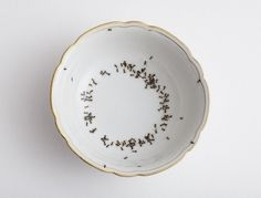 Evelyn Bracklow hand-paints ants on fine porcelain and dinnerware. I need every damn piece in the collection...and I'm not kidding.