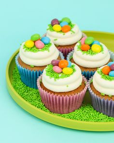 These Easter cupcakes are so simple yet gorgeous in our pastel BakeBright greaseproof liners topped with green grass sprinkles and candy eggs. I Sweets & Treats #eastercupcakes #easterpartyideas #eastersweets #easterbasketcupcakes #eastersprinkles